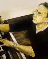 Graeme Koehne Adelaide Composer is playing a piano and writing music with a yellow glow