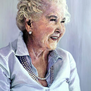 A portrait painting of an older woman wearing a silk shirt and a string of pearls. She is smiling , her cheeks are slightly flushed and there is a delicate purple light in the painting.